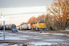 Union Pacific EMD GP60 No. 1082 sits idle in the yard at the head of a mixed freight movement. (andrew_busse) Tags: railroad winter sunset snow yard train truck lens photography nikon midwest busse pacific outdoor no union trains andrew iowa number dodge 1855mm dslr ram freight railroading emd oskaloosa 1082 d3200 gp60 gp62