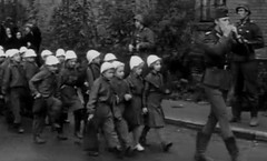Outing and holiday (theirhistory) Tags: girls boys hat kids children shoes war europe wwii ww2 soldiers raincoats germans