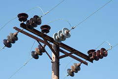 Electric Lines with Glass Insulators (bangela95) Tags: wood blue sky glass lines electric metal wooden nikon industrial utility pole wires rusted d750 insulator httpswwwpinterestcomoffthehookangelabecksphotography