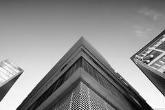 Climber (Erik Schepers) Tags: sky white black building up architecture modern buildings germany looking dusseldorf deutchland medienhafen