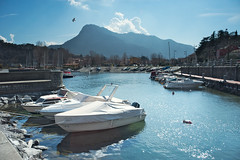 The first warm sunshine of spring (Marco MCMLXXVI) Tags: travel italy lake como primavera tourism water colors sunshine landscape lago bay harbor boat spring waterfront outdoor sony porto lombardia lecco valmadrera waterfornt par nex5