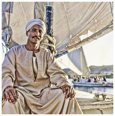 Felucca Captain _ River Nile (Cozy61) Tags: travel portrait water vintage river boat ancient jobs grunge gritty tourist nile captain sail mast turban aswan felucca galabeya upperegypt gabella