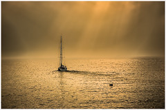 Sailing around Hong Kong (Chas56) Tags: ocean sunset sea mist water canon hongkong harbor boat sailing harbour rays sunrays canon5dmkiii