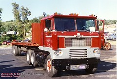 White cabover, Greensburg, PA.  6-12-2003 (jackdk) Tags: white tractor truck semi trailer semitruck flatbed tractortrailer cabover truckshow whitetruck whitemotortruck caboverwhite