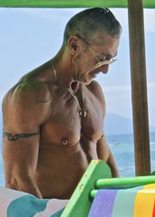 IMG_1140 (danimaniacs) Tags: shirtless pierced man hot sexy guy beach pecs tattoo muscle muscular jewelry stud mansolo
