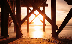 Troll Under The Pier (Piizzi) Tags: winter blackandwhite water ir photographer surfing orangecounty oc sanclemente swell videographer pizzitola surfphotographer infraredphotographer chrispizzitola piizzi piizzicom piizzii januaryfirstswell