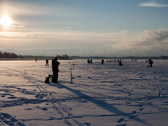 Fishing (jarimakila) Tags: winter snow ice fishing helsinki vanhankaupunginlahti lumi circularpolarizer arabianranta j pyrpolarisaatio throughaholeinice