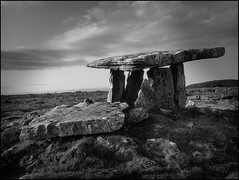 Poulnabrone Dolmen-BW (Firery Broome) Tags: ireland sky blackandwhite sun monochrome field grass clouds photoshop landscape blackwhite rocks stones historic 365 cairn sunsetting bronzeage apps neolithic chambertomb countyclare poulnabrone historicplaces alienskin irishlandscape poulnabronedolmen blackandwhitelandscape viveza 570uz olympus570 historicireland exposurex historicicons irishhistoric