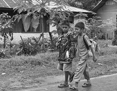 Relax, He's Just taking a Picture (Beegee49) Tags: school boys walking children philippines negros schoolboys bulanon