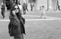 Petra (Lszl K.) Tags: bw sunglasses lady nikon phone 21 kodak 14 7 iso bologna ke epson f3 piazza nikkor eastman 50 developed exposed santo 250 ais stefano yellowfilter v550 217 doublex pfg y48 5222 d96 sixgatesfilms 14reels ke5222 puntofotogroup pfgmilano 721