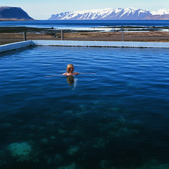 In the Western fjords (Iurii & Natali) Tags: blue wild sky mountains hot color 120 6x6 film nature water pool girl rollei swim vintage naked nude iceland spring pretty fuji open view natural nu may slide velvia chrome blonde western integral fjord analogue spa therm diafilm xenotar 6008