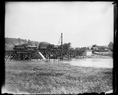 Trestle bridge (gordon_morales) Tags: railroad trestle bridge glass river construction plate negative
