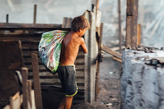 Boy With Sack of Charcoal, Smokey Mountain (AdamCohn) Tags: boy sunset dusk smoke philippines streetphotography manila sack coal smokeymountain tondo ulingan adamcohn wwwadamcohncom ulinganslums