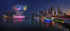Singapore Skyline Fireworks (Ken Goh thanks for 2 Million views) Tags: longexposure blue sunset sky cloud reflection water skyline marina evening bay sand singapore pentax smooth sigma nopeople panoramic cbd 1020 mbs centralbusinessdistrict ndfilter k5iis