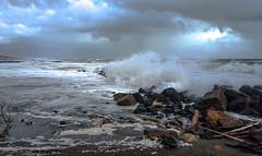Una mareggiata (johnfranky_t) Tags: t nuvole pioggia massi onde nere schiuma detriti johnfranky