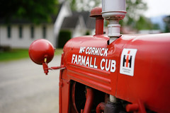 """McCormick Farmall Cub"" (Eric Flexyourhead (shoulder injury, slow)) Tags: old red canada detail museum zeiss vintage cub bc bokeh britishcolumbia farm vibrant vivid equipment agriculture farmall chilliwack mccormick fragment shallowdepthoffield ata internationalharvester 55mmf18 mccormickfarmallcub atchelitzthreshermensassociation sonyalphaa7 zeisssonnartfe55mmf18za atchelitzthreshermensassociationmuseum"