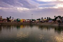 Serene evening (Premnath Thirumalaisamy) Tags: nature water canon reflections temple eos evening day peace cloudy kitlens serene 1855mm watertank tamilnadu kumbakonam 550d indiatemples magamaham