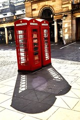 Iconic London phone boxes, casting shadows, in the morning sun. Shadow Shadows And Backlighting Phonebox Iconic Red Phonebox Iconiclondon at Covent Garden (Rupert Hitchcox LRPS) Tags: shadow phonebox iconiclondon iconicredphonebox shadowsandbacklighting