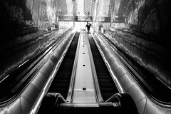 Into the city (Warfield360) Tags: seattle city urban man building sign architecture reflections pattern guitar geometry escalator skylight trainstation backpack pioneersquare traveler 3rdjames