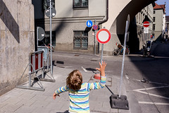 . (www.piotrowskipawel.pl) Tags: street city boy lines architecture germany circle mnchen bayern kid gg play geometry shapes streetphotography photojournalism documentary roadsign lollipop reportage decisivemoment documentaryphotography colorstreetphotography pawepiotrowski piotrowskipawelpl