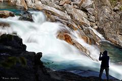 Wild river, courageous photographer (PaulGsell) Tags: man water river schweiz switzerland tessin ticino rocks wasser fotograf photographer stones steine mann fluss felsen thunderous verzasca tosend