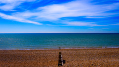 Bexhill Beach (Nick_Rowland) Tags: blue sky beach clouds sussex coast shingle sunny groyne bexhillonsea