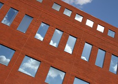 Sky Windows (Karen_Chappell) Tags: city blue windows urban brown abstract reflection building brick geometric window architecture clouds newfoundland reflections downtown angle geometry stjohns tilt rectangle nfld
