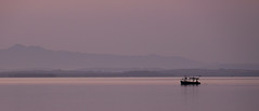 Dawn on the Bay (Dalliance with Light) Tags: ocean sea sky mist seascape mountains water bicycle fog sunrise reflections landscape dawn bay boat haze cu cuba cienfuegos