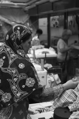 Shopping in the market (Job Homeless) Tags: blackandwhite hongkong streetphotography jordan f2 58mm helios44m monochorme streetsnap canon6d