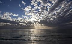 how much is enough? (Satirenoir) Tags: ocean sunset sunlight beach treasureisland florida sunsetbeach drama stpetebeach godlight