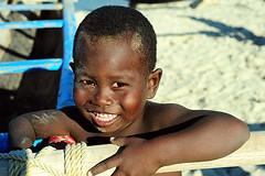 MDG-Morondava-1108-13-v1 (anthonyasael) Tags: ocean africa wood boy sea people black water smile smiling horizontal island happy boat canal wooden fishing fisherman child african indianocean happiness sail afrika fishingboat madagascar enjoying waterscape sailingboat fishermanboat morondava childrenonly oneboyonly onechildonly anthonyasael canalofmozambique