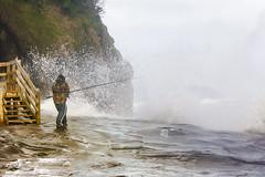 Crazy Fisherman (fantommst) Tags: ocean sea newzealand seascape beach weather clouds movement fishing fisherman rocks waves auckland nz rough tasman swells westcoast headland muriwai inward lisaridings fantommst