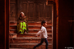 Reminiscence (ujjal dey) Tags: streets kid wait oldlady contemplative galli reminiscence alleys benaras 2016 passby ujjal nikond90 ujjaldey defusedlights ujjaldeyinvaranasi