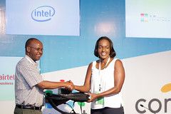 Angela Ng'ang'a recieves her award for the longest serving Member of the connected Summit
