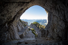 giants' view (nils_P) Tags: blue sky sun mountains alps green canon rocks cave