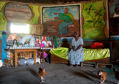 Ethiopian woman inside her traditional painted and decorated house, Kembata, Alaba kuito, Ethiopia (Eric Lafforgue) Tags: poverty africa woman house color building art chicken geometric home horizontal architecture illustration painting religious outdoors bed women mural village adult painted traditional faith religion decoration culture christian indoors hut round tradition ethiopia naive ethnic residential orthodox circular oneperson decorated hornofafrica riftvalley eastafrica depiction abyssinia onewomanonly ruralscene 1people alaba toukoul tukul halaba painteddecoration kembata kulito ethio163261