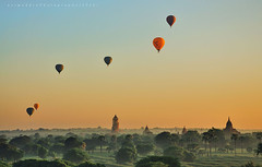 The hot air ballons over temples in sunrise at Bagan, Myanmar. (azimuddin_ibrahim) Tags: old city morning travel light sunset panorama hot art heritage tourism beautiful up field silhouette architecture sunrise temple dawn evening pagoda boat fly twilight ancient scenery asia ray cityscape background burma buddhist air famous hotair balloon culture buddhism landmark structure historic east journey sacred myanmar spirituality spiritual vacations attraction bagan