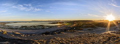 playa de caleta (Mauro Esains) Tags: patagonia costa sol atardecer mar nikon sigma playa paisaje cielo otoo gran angular aire ocaso libre vegetacin caleta nuves 10mm nikonsigma