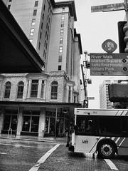 (photo.po) Tags: blackandwhite wet monochrome rain canon downtown texas streetphoto streetcorner citybus sanantoniotx flickrclubsa canoncompactcamera canong10