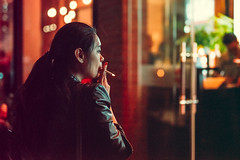 Quick Smoke (Jon Siegel) Tags: china city light people urban woman girl mystery bar night 50mm restaurant evening nikon shanghai cigarette smoke 14 chinese sigma smoking flame cig mysterious bund daydreaming thebund d810 sigma50mmf14art