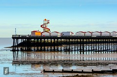 The Pier (kh4ki) Tags: uk red sea england color london water yellow clouds pier kent colours shades huts oranges