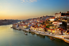Porto View. (M Artin.) Tags: old city travel light sunset orange house tourism portugal water yellow horizontal buildings gold dawn evening harbor town ancient downtown cityscape hill culture down center historic unesco part porto douro historical aged belarus portuguese embankment oporto overview duoro destinations zzzacmaaaifpenehfpdidbdgdj