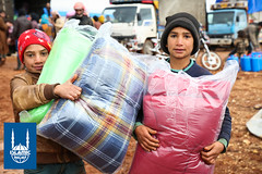 Children receive blankets from Islamic Relief as part of winterization relief in Lebanon.