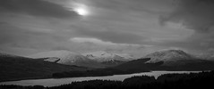 Loch Tulla (Leanne Boulton) Tags: uk trees light shadow sky blackandwhite bw cloud sun sunlight white mountain lake black mountains detail texture nature monochrome rural canon landscape mono scotland blackwhite highlands scenery mood darkness natural outdoor widescreen scenic atmosphere wideangle scene shade crop 7d brooding loch wilderness cinematic range depth tone atmospheric lochtulla glaciation scottishhighlands landscapephotography
