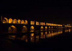 a view of the si-o-seh bridge at night highlighting the 33 arches, Isfahan Province, isfahan, Iran (Eric Lafforgue) Tags: city travel bridge urban reflection building tourism horizontal architecture night buildings outdoors persian asia arch iran middleeast bridges engineering persia arches nobody landmark architectural illuminated civil iranian copyspace centralasia esfahan isfahan ispahan siosehpol   siosehbridge  iro isfahanprovince  colourpicture polesioseh  hispahan iran034i3669