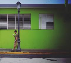 Cigarette break. (lashjuliet) Tags: street travel streets color puertorico surfer sony streetphotography symmetry solo cinematic 16mm traveler streetshot sonyalpha sonynex