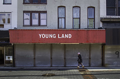 Young Land (crabsandbeer (Kevin Moore)) Tags: old city people urban abandoned sign architecture women closed decay baltimore age vacant irony signage oldwoman slums oldtownmall