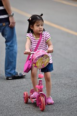 Symphony in pink (jeremyhughes) Tags: park street pink people girl childhood thailand toys nikon child zoom bangkok candid barbie scooter attitude d750 accessories nikkor handbag strips striped stripy confidence crocs lumpinipark 80200mmf28 accessorise