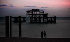 Companionable Silence (prueheron) Tags: ocean sunset sea beach pier seaside brighton westpier