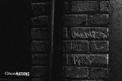 Carved In Stone (Ghost Of Nations Photography And Digital Art) Tags: blackandwhite bw black building brick dark alley gloomy stonework carving names neogothic freemasons masonictemple liminal laporteindiana newgothic ghostofnations ghostofnationsphotography